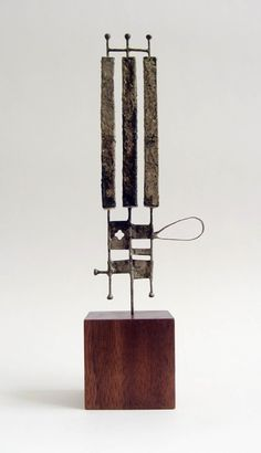 Untitled #206 (2009) by American artist Jay Kelly (b.1961). Metal, 7 x 2.5 x .25 in. Base: wood, 2 x 2 x 1.75 in. via the artist's site