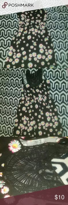 Brand new daisy dress Cute floral dress with black see through material on back. True colors of the dress are in the last picture! Size: L 11-13 brand:no boundaries No Boundaries Dresses