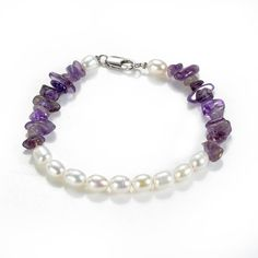 White Oval Pearl Beads and Nugget Amethyst Bracelet Gemstone Jewelry for Women Girls This gorgeous bracelet was created with nugget amethyst gemstone . Amethyst Armband, Amethyst Bracelet, Amethyst Gemstone, Baroque Pearl Necklace, Pearl Jewelry, Gemstone Jewelry, Pearl Beads, Pearl Necklaces, Sterling Silver Bracelets