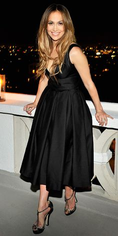 Jennifer Lopez At a private dinner hosted in honor of Jennifer Lopez, the singer looked refreshingly sweet in a fitted Dsquared2 LBD with a full skirt, and embellished T-strap heels.