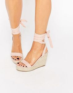 Talent tie leg wedge sandals by Asos. Sandals by ASOS Collection Leather-look upper Wraparound tie straps Woven-style sole High wedge h...