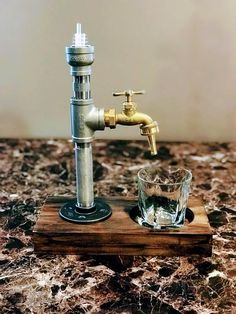 Exclusive handcrafted drink dispenser. The perfect rustic addition that your home bar, kitchen, or man cave is missing. Product is carefully crafted and handmade to order. May choose natural, light, medium, or dark stain. Made with stainless steel pipes. ***All US orders will arrive by