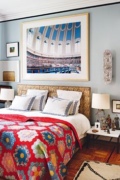 A Worldly Affair In NYC / Love the sconce on the wall to the right of the bed.