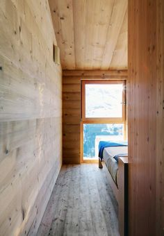Wake up to this view? I should say so. (Italian Alps village of Madesimo; wood-lined bedroom)