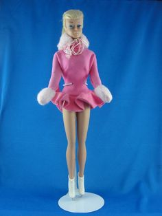 1964  Swirl ponytail wearing 'Skater's Waltz'  cotton candy ensemble, mock fur tie on the collar, and thumbless fuzzy mittens, and soft rubber ice skates...SIMPLY ADORABLE.