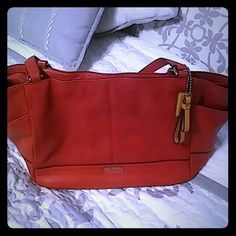 """Authentic Coach leather shoulder bag red EUC This is an awesome Coach bag with 2 outside slip pockets, 2 inside slip & 1 zip pocket. Inside is the b original satin lining with the serial number tag as shown I the 2nd pic. Size is 18"""" wide x 9 high x 9""""deep with a wider bottom. Shoulder drop is 9"""". The hardware is silver. The red is a gorgeous orange red. I have a matching wallet listed separately. If bundled you would get a additional 25% off!! Coach Bags Shoulder Bags"""