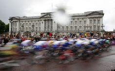 The pack of cyclists ride past Buckingham Palace in the rain during the Women's Road Cycling race at the 2012 Summer Olympics, Sunday, July 29, 2012, in London.