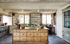 This country home on the Belgian countryside features a custom kitchen island that was designed to look like an antique, echoing the inherent charm of the rest of the house. Rustic Kitchen Decor, Farmhouse Style Kitchen, Modern Farmhouse Kitchens, French Farmhouse, Kitchen Wood, Rustic Farmhouse, Antique Kitchen Island, Kitchen Ideas, French Kitchens