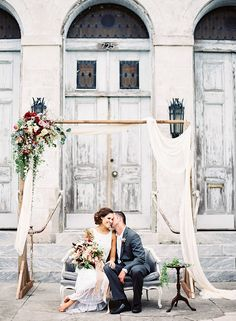 Draped Ceremony with Vintage Decor | Marissa Lambert Photography | http://heyweddinglady.com/botanical-opulence-wedding-red-plum/