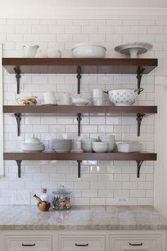 Do this | Designer: Carla Aston, photo by Tori Aston | Farmhouse kitchen, subway tile, floating shelves