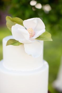 Magnolia Flower on Wedding Cake by Angel Cakes Bakery | photography by http://dianaelizabethblog.com/ | floral design by http://thegaragebyivy.com/ | event design by http://angelasabandesign.com/