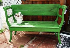Upcycled antique chairs repurposed as a garden bench.