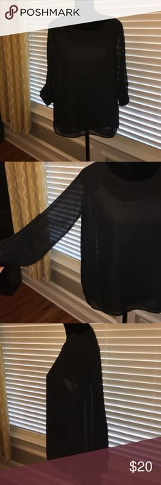 Jennifer Lopez Black Sheer Blouse Size Small Jennifer Lopez Black Sheer Blouse Size Small with beautiful pleated details on the back. I only wore this one time. It is sheer black so you would need a cami underneath. This comes from a smoke free home, no holes, stains or missing pieces. Fits like a small/medium. Jennifer Lopez Tops Blouses