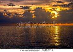 Beautiful Sea Sunset Beach at Phuket Thailand. Sunset on the beach with cloud on sky. dramatic color