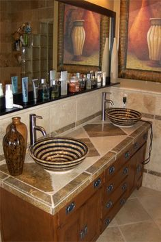 KCK bathroom remodeling ideas: Traditional Sinks are Out, Basin Sinks are In - Basin sinks that sit on top of the counter or vanity are one of this year's hottest trends. There are a variety of styles, from simple ceramic bowls to large shell-style basins.