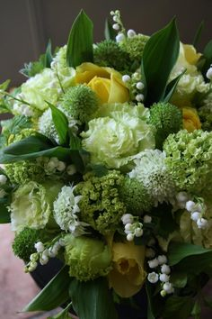 white, yellow and green floral arrangement