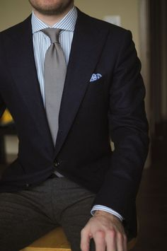 Navy blazer, white shirt with light blue stripes, light grey tie, dark grey pants | Men's Fashion | Menswear | Men's Outfit for the Office | Shop at DesignerClothingFans.com