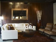 Modern-living-room-design-with-brown-carpet-modern-wooden-walls-chic-furnitures-round-table-and-decorations