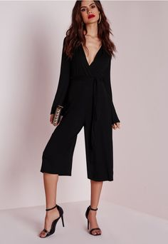 Culottes are THE trouser shape of the season and we have taken it that one step further and made our lust-worthy jersey culotte jumpsuit! Rock the party style and be ahead of the game when you team this baby with fluffy barely there heels. ...