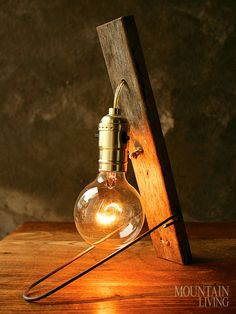 Salvaged hardwood and a bare filament bulb desk lamp MORE AT http://www.mountainliving.com/article/ml-shopping
