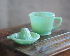 Vintage Jadeite Measuring Bowl and Juicer Set. $44.50, via Etsy.