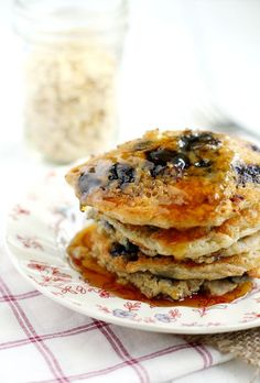 The perfect breakfast - blueberry oatmeal pancakes with warm maple syrup. Easy recipe, and so tasty!