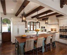 Spanish Style Kitchens | Iron lantern pendants are perfect for a Spanish style kitchen.
