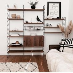 String is a Swedish company and sole producer of the original String Shelving; a timeless design by Nils Strinning. Created in 1949 this humble shelving system has become one of the twentieth century's foremost design icons. Living Room Green, Home Living Room, Living Room Furniture, Scandinavian Shelves, String Regal, String Shelf, Living Room Shelves, Restaurant Interior Design, Home Office Space