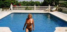 Maggie in Alicante Nudists swimming pool