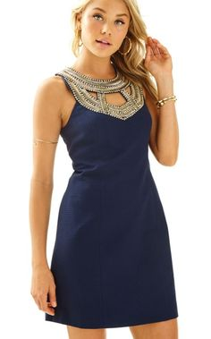 For us, special occasions are the perfect opportunity to wear a shift dress. The Carlton Shift will make you look and feel great at your special event. It's a solid shift with a gold beaded neckline that really dresses it up.