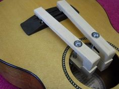 Bridge Clamps - Homemade ukulele bridge clamps fashioned from wood and hardware.