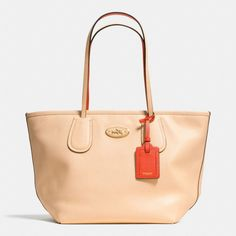 The Coach Taxi Zip Top Tote In Two Tone Colorblock Leather from Coach