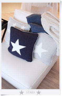 Navy and yellow star pillow in this design for bed