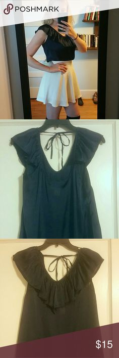 Blouse Dark blue silky blouse from Francesca's. Wear tucked in a high waisted skirt of with some white skinny jeans. Has a ruffle collar and is tied in the back. If you don't like the price, make me an offer! Francesca's Collections Tops Blouses