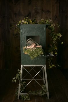 baby photo in hunting blind by San Antonio photographer