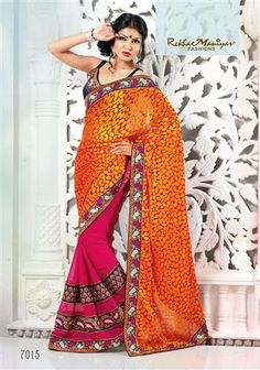 """A fascinating combination of cherry pink with orange Brasso (pallu) and cherry pink georgette patti. The horizontal patti stich patta design giving out the latest trendy look to any woman at her every occasions. The golden foil touch on the Brasso (pallu) adds to the overall look, touch and feel of the Saree. This designer saree having contrast navy blue color blouse material along with embroidery designed border. """"Fashion with Tradition."""""""