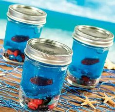 Party favors or a kid gift...jelly beans on the bottom. Blue jello and when the jello is almost set put a Swedish fish in the jello. I think baby jars would be cute too for the toddlers. And its all food so they can eat it.