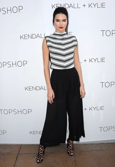In her Topshop line's semi-sheer culottes with Hermès sandals at the Kendall + Kylie Topshop collection launch party in Los Angeles.   - ELLE.com