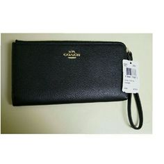 Coach wristlet wallet New with tags black leather wristlet wallet. Gold hardware. Posterior zipped pocket. 6 credit card slots and several compartments. Coach Bags Clutches & Wristlets