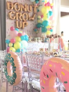 """Inflatable donuts tied to chair backs from a """"Donut"""" Grow Up 1st Birthday Party on Kara's Party Ideas 