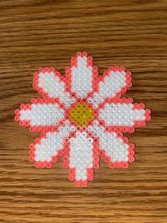 Pink, yellow and white perler bead flower. Magnet is on the back Easy Perler Bead Patterns, Melty Bead Patterns, Perler Bead Templates, Diy Perler Beads, Perler Bead Art, Beading Patterns, Loom Patterns, Loom Beading, Hamma Beads Ideas