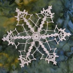 In my opinion, this is one ugly flake. Tons of picots down the slip-stitched chains. You may do whatever you'd like with snowflakes you ma...