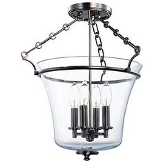 Historic nickel finish gives this metal and glass ceiling light a dark allure that glows from four candelabra bulbs.