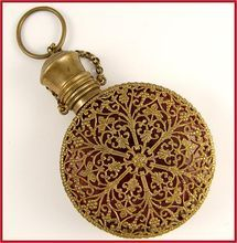 """Antique Cranberry Glass & Ormolu Filigree Hinged Scent Bottle Chatelaine. An antique 19th century cranberry glass scent or perfume bottle chatelaine surrounded by ornate filigree-work, exceptionally rare and stunning to display! Encasing the glass are two sections of ormolu filigree """"lace"""", beautifully patterned in the style of the old Rosette or Rose stained glass windows, with geometric and tracery panels. The Antique Boutique on Ruby Lane http://www.rubylane.com/shop/theantiqueboutique"""