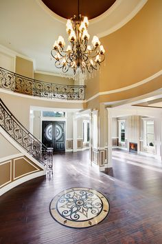Grand Entry with elegant chandelier and sweeping staircase.