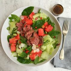 #summer dining of @gingerpigltd fillet steak on a bed of @freshandnaked #seasonal salad leaves @wildcountryorganics cucumber ribbons watermelon and mint leaves. Dressed with @wasabigrowersuk champonzu with yuzu juice @clearspringuk toasted sesame oil & lime juice with chillies. #colourful & #nutritious light dining - loving the fruitier additions of yuzu watermelon & cucumber! #healthyeating #londonfoodie #farmersmarkets #summertime #healthychef #lowcarb #leanmeals #gourmet #foodlover…