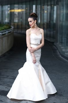 Anne Barge Spring 2015 Vendome wedding gown has a beautiful classic yet modern fit and flare silhouette. Decorative stitching on hips and structured silk in blush set this gown apart. French bustle. P