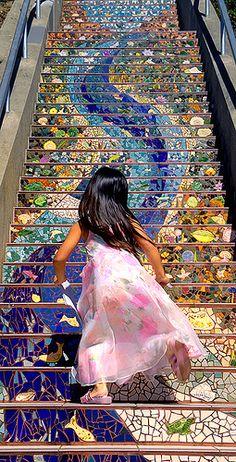 Girl runs up 16th Avenue tiled steps-San Francisco