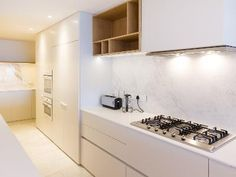Modern white kitchen with Marble design. Serviced, well equipped self catering Apartments and Villas in Cape Town!