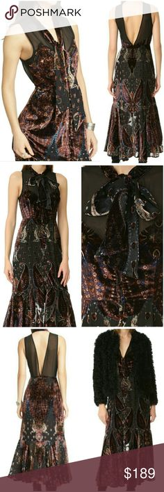 NWT FREE PEOPLE LUX VELVET BURNOUT MAXI RARE Take boho chic to another level!  Dress features a long relaxed fit A decorative strap to tie at neck See through fabric at top of bust Decorative covered buttons at front from top to bottom Beautiful paisley pattern through out Hidden side zip.  Lined.  Style with flats and loose waves! Free People Dresses Maxi